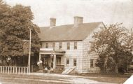Ketcham Inn c.1900 with bicycle rack in front.  The dirt road at the edge of the photo was known then as the King's Highway